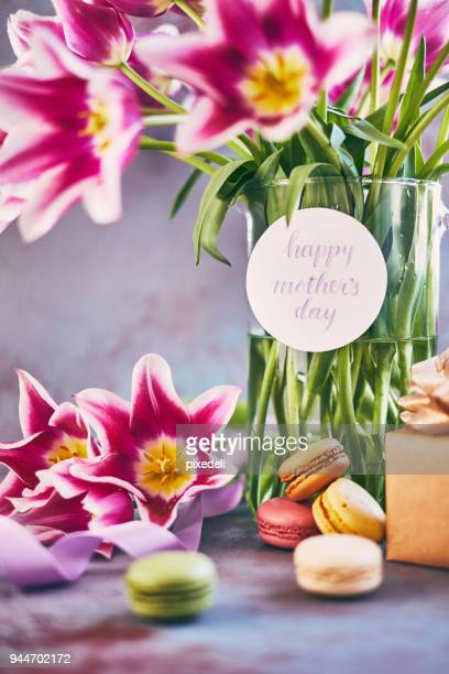 purple tulips bouquet for mother's day with brush-lettering card - mothers day card stock pictures, royalty-free photos & images