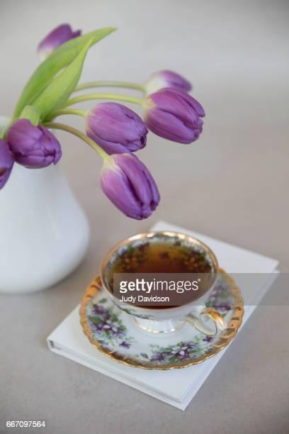 Purple tulips tea and book