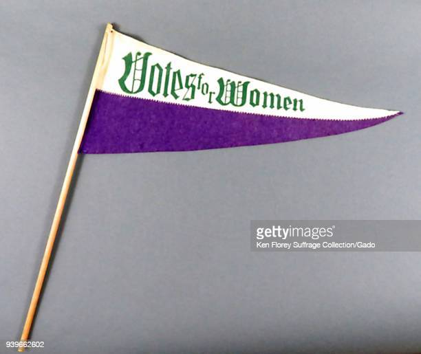 Purple white and green suffrage pennant or banner with the message 'Votes for Women ' produced for the American market with a color scheme borrowed...