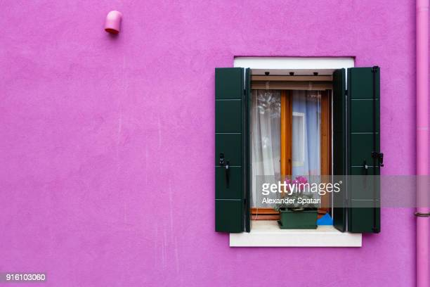 purple window and facade of a vibrant colorful house - wall building feature stock pictures, royalty-free photos & images