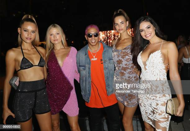 Purple with Sports Illustrated models attend the 2018 Sports Illustrated Swimsuit show at PARAISO during Miami Swim Week at The W Hotel South Beach...