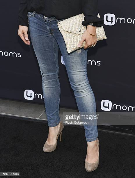 Purse and shoe detail actress Beverley Mitchell attends 4moms Launches SelfInstalling Car Seat at Petersen Automotive Museum on August 4 2016 in Los...