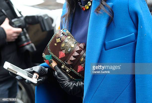 Purse is seen outside the DKNY show on February 9, 2014 in New York City.