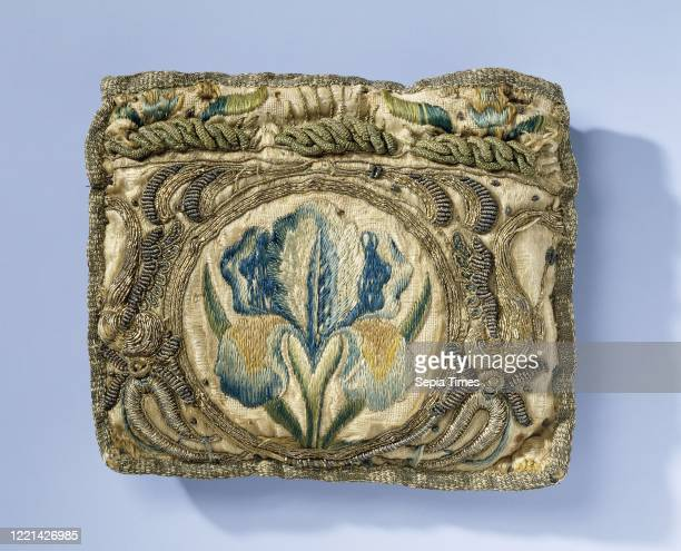 Purse of yellow silk, embroidered with iris in multicolored floss and ornaments in gold thread, Rectangular purse of yellow silk. On the front and...
