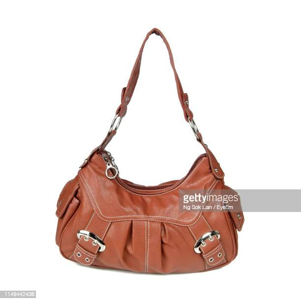purse on white background - brown purse stock pictures, royalty-free photos & images
