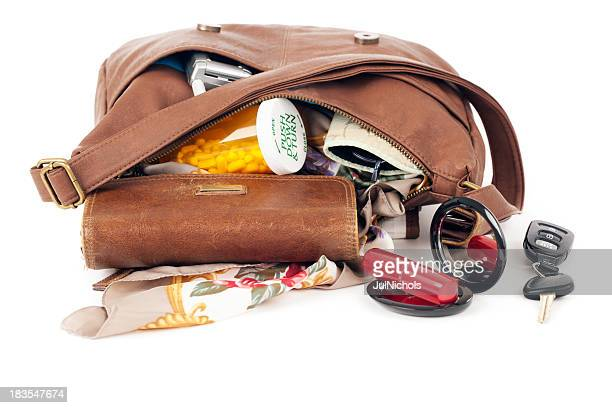 purse: open with contents spilling - clutch bag stock pictures, royalty-free photos & images