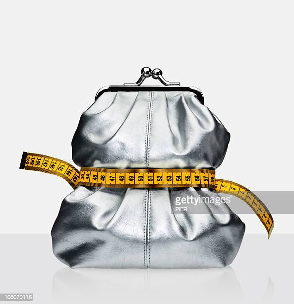 purse with measuring tape around it - gray purse stock pictures, royalty-free photos & images