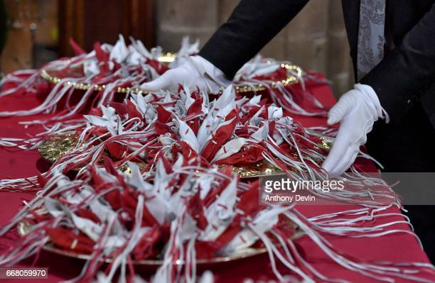 Purses containing Maundy money are adjusted ahead of the Royal Maundy service at Leicester Cathedral on April 13 2017 in Leicester England The Queen...