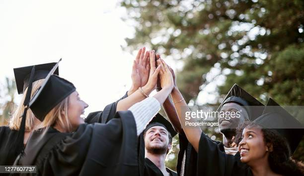 pursuing a bright future - alumni stock pictures, royalty-free photos & images