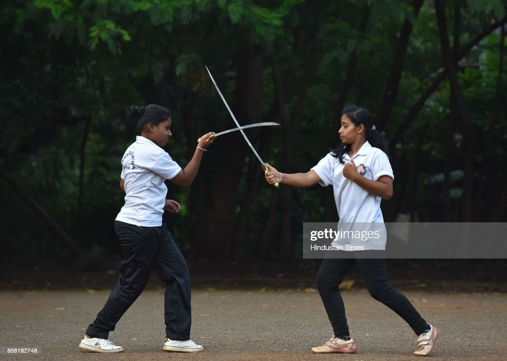 Purvi Ganve (R) and Samruddhi Jadhav (L) display Sword Fight, a type of Silambam, a weapon based Indian Martial arts, on October 4, 2017 in Pune, India. The word Silambam means either a mountain or merely to sound (as verb). While the Silambam fencers are fighting, the weapon makes sound. This might have been the cause for its being named as Silambam.