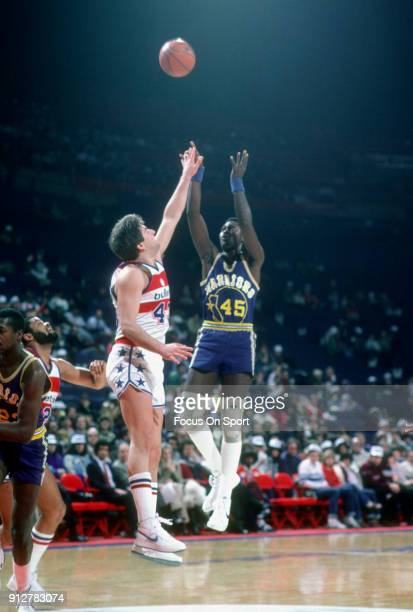 Purvis Short of the Golden State Warriors shoots over Jeff Ruland of the Washington Bullets during an NBA basketball game circa 1982 at the Capital...