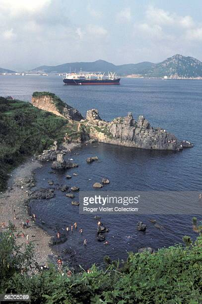 Pusan Swimmer on the coast and cargo boat in the natural harbour September 1980