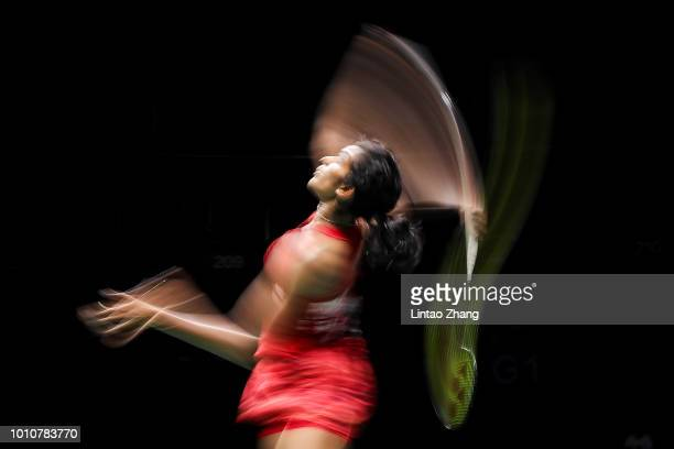 Pusarla V. Sindhu of India hits a shot against Akane Yamaguchi of Japan in their Women's Singles Semifinals match during the Badminton World...