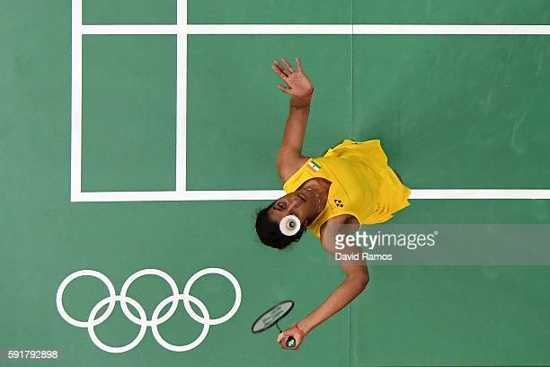 Pusarla V Sindhu of India plays a shot during the Women's Badminton Singles Semifinal against Nozomi Okuhara of Japan on Day 13 of the Rio 2016...