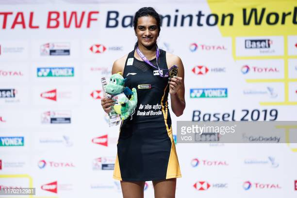 Pusarla V. Sindhu of India poses with her medal after the Women's Singles final match against Nozomi Okuhara of Japan during day seven of Total BWF...