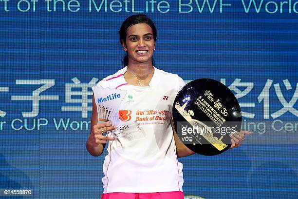 Pusarla V Sindhu of India poses with trophy after winning women's singles final match against Sun Yu of China on day six of BWF Thaihot China Open...