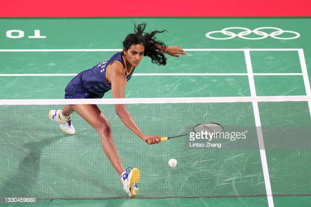 Pusarla V. Sindhu of Team India competes against Ksenia Polikarpova of Team Israel during a Women's Singles Group J match on day two of the Tokyo...