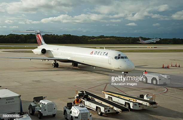 Push back a Delta Airways MD 88 leaving the stand at Tampa Florida USA