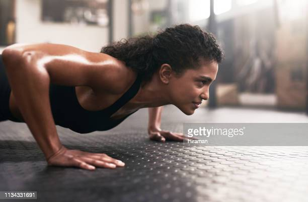 push beyond your limits - push ups stock pictures, royalty-free photos & images
