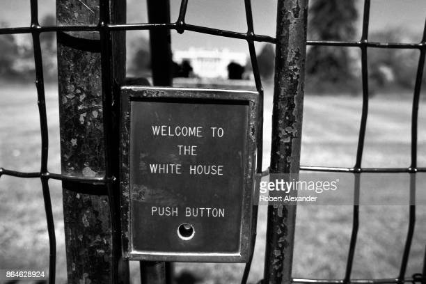 A push button affixed to the White House fence in Washington DC in 1977 is used by tourists to trigger a prerecorded informational recording