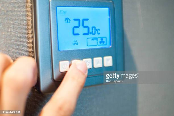 push button airconditioner remote control - touchpad stock pictures, royalty-free photos & images