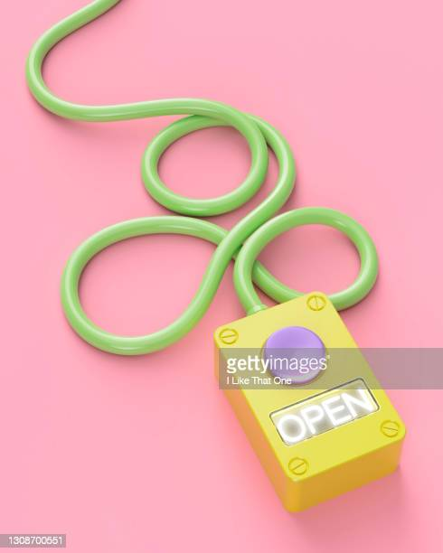 a push button box is connected to a cable, the word open is illuminated - atomic imagery stock pictures, royalty-free photos & images