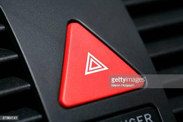 Push button on car dashboard for hazard lights