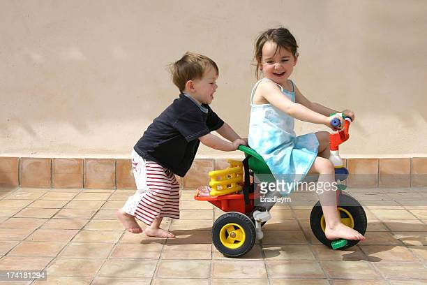 push me - tricycle stock pictures, royalty-free photos & images