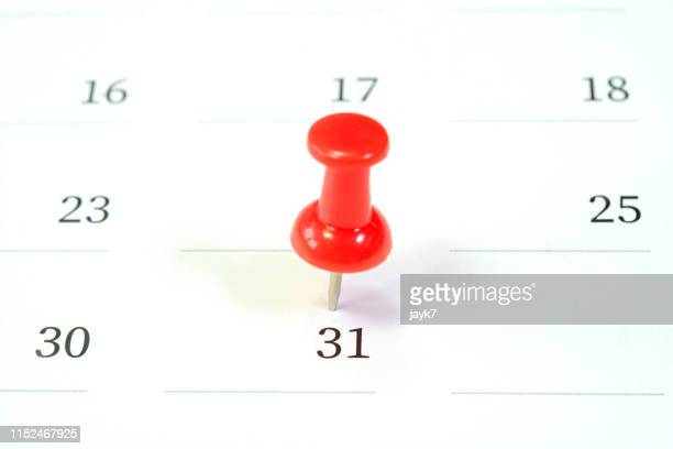 push pin on calendar - number 31 stock pictures, royalty-free photos & images