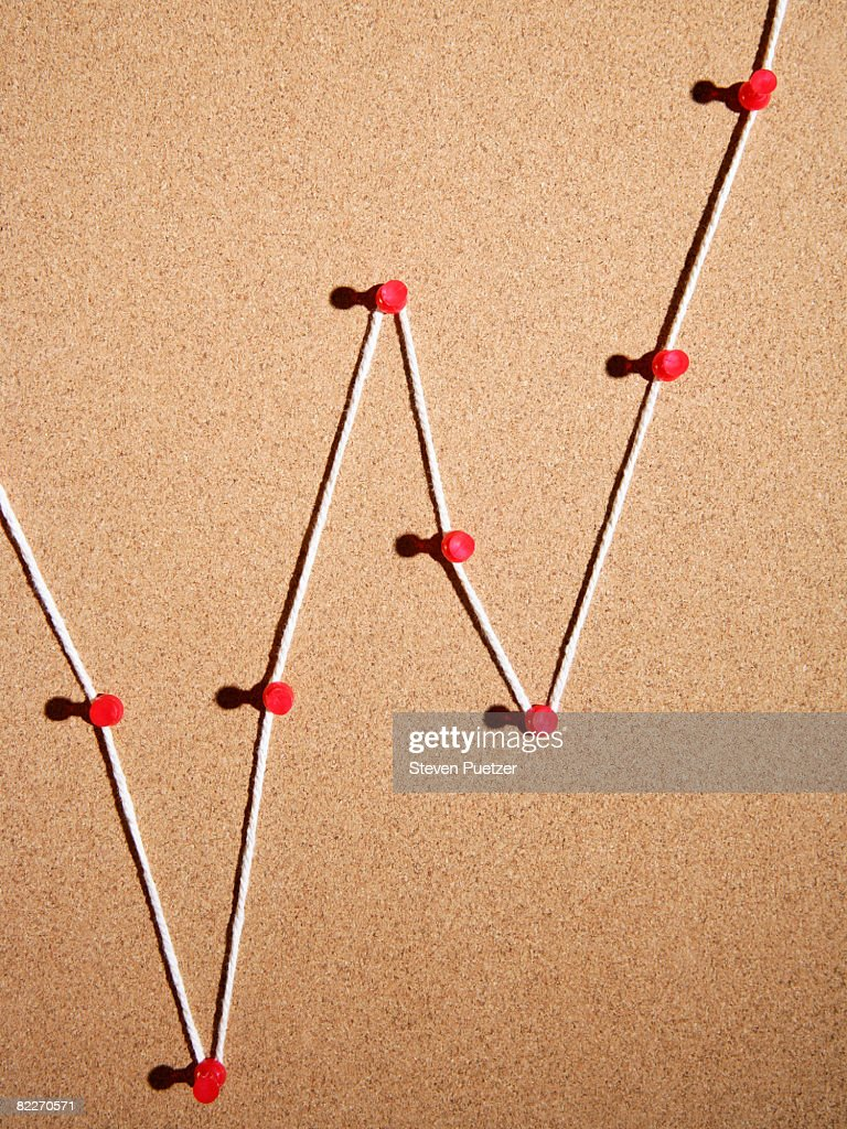 Push pins and string on cork board : Stock Photo
