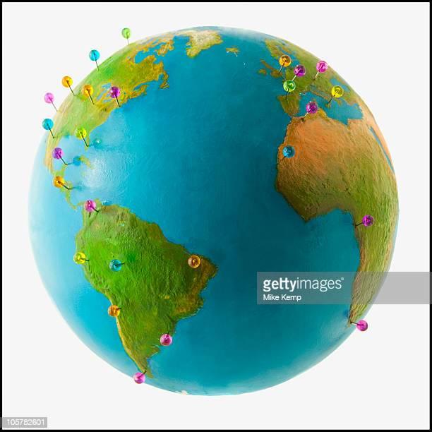 Push pins on globe