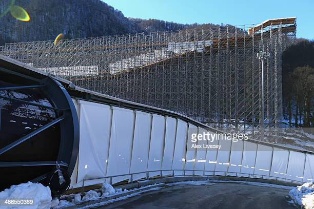 Push start practice slope towers above the Sanki Sliding Centre on scaffolding ahead of the Sochi 2014 Winter Olympics on February 2, 2014 in Sochi,...