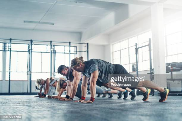 push yourself a little further each day - circuit training stock photos and pictures
