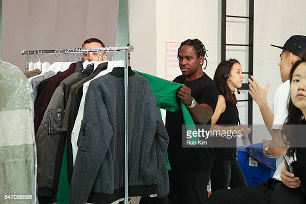 Pusha T looks over outfits backstage at the John Elliott fashion presentation during New York Fashion Week: Men's S/S 2017 at Skylight Clarkson Sq on...