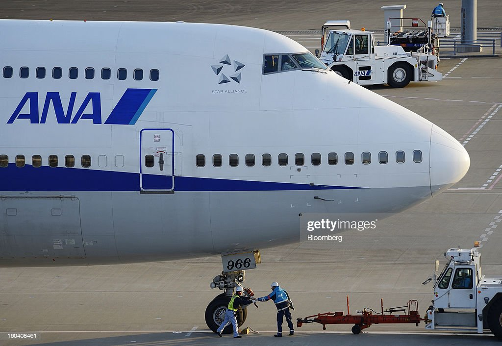 A pushback tug is disconnected from a Boeing Co. 747-400 aircraft operated by All Nippon Airways Co. (ANA) at Haneda Airport in Tokyo, Japan, on Wednesday, Jan. 30, 2013. ANA has canceled a total of 784 flights, affecting 74,200 passengers through Feb. 12, since a Jan. 16 incident that led to the global grounding of Boeing Co. 787s, according to figures from the company. Photographer: Akio Kon/Bloomberg via Getty Images