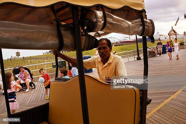 A pushcart worker waits for customers along the boardwalk in Atlantic City on July 29 2014 in Atlantic City New Jersey Since January of 2014 four of...
