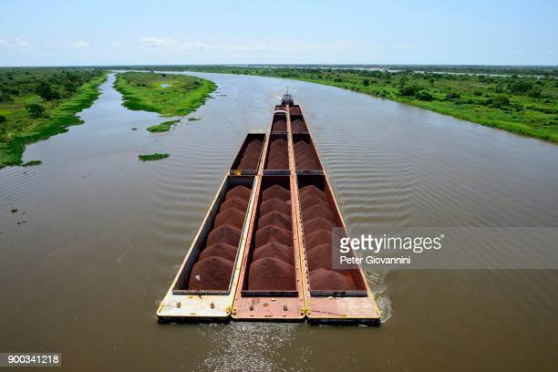 pusher with iron ore cargo, rio paraguay, concepcion, paraguay - paraguay stock photos and pictures