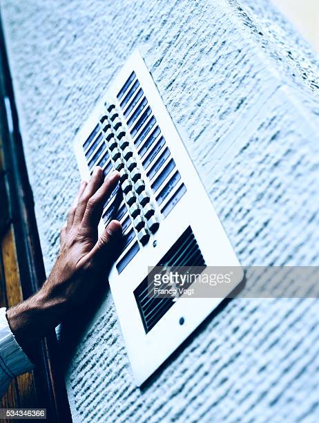 pushing button on building intercom - intercom stock pictures, royalty-free photos & images