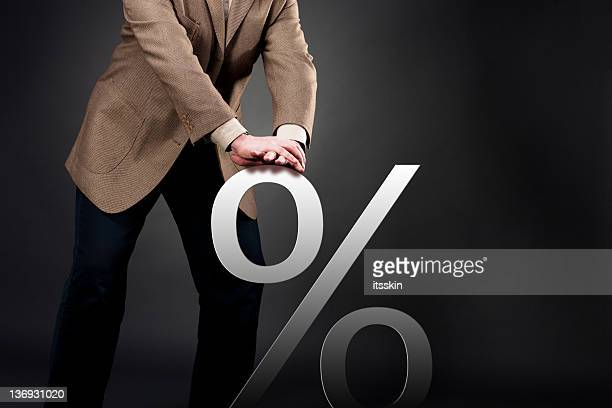 pushing down interest rate - interest rate stock pictures, royalty-free photos & images