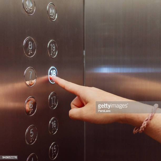 pushing elevator button - button stock pictures, royalty-free photos & images