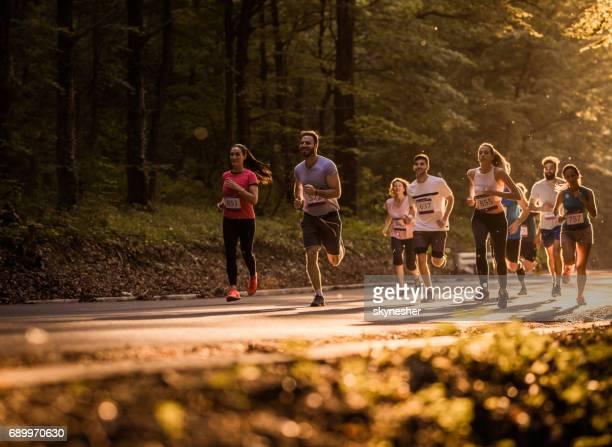 pushing endurance limits to maximum! - half_marathon stock pictures, royalty-free photos & images