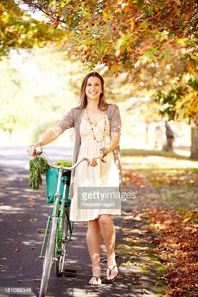 Pushing her bike home from the store