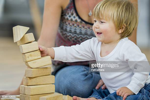 Pushing Over a Pile of Blocks