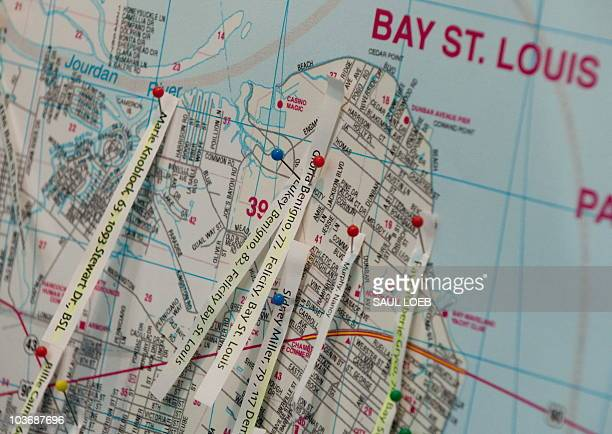 Pushpins mark the spots on a map showing where bodies were found as reporters kept track of their locations in the New Orleans area as part of the...