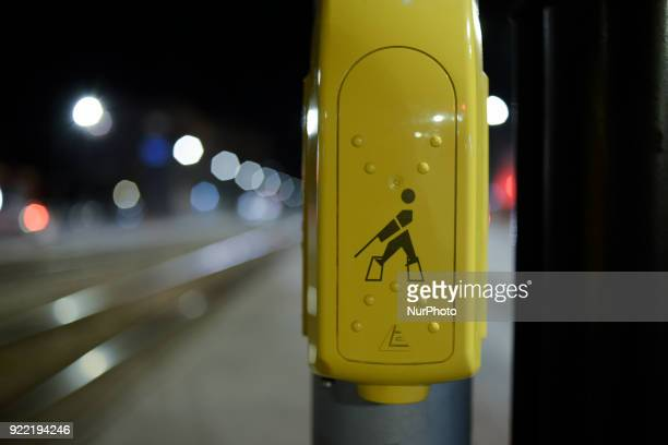 A pushtowalk button for disabled pedestriands is seen near a tramway crossing in Warsaw Poland on February 21 2018