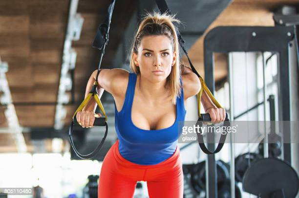 pushups workout with suspension cables. - endurance stock photos and pictures