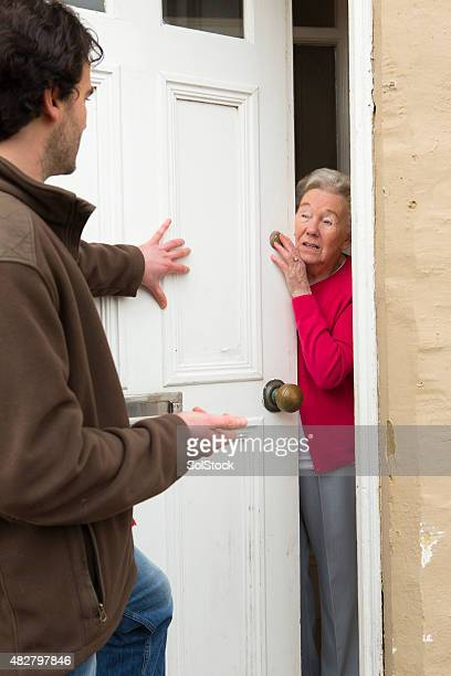 pushy salesman - knocking on door stock photos and pictures