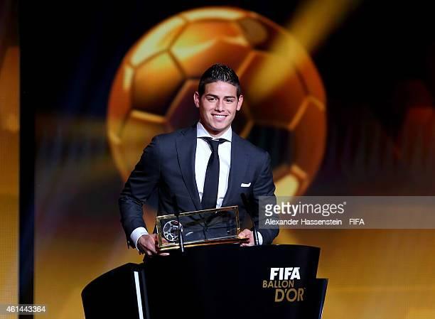 Puskas Award winner James Rodriguez of Colombia and Real Madrid accepts his award during the FIFA Ballon d'Or Gala 2014 at the Kongresshaus on...