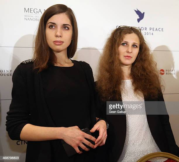 Pussy Riot members Nadezhda Tolokonnikova and Maria Alyokhina arrive to speak at the Cinema for Peace 2014 press conference at the Regent Hotel on...