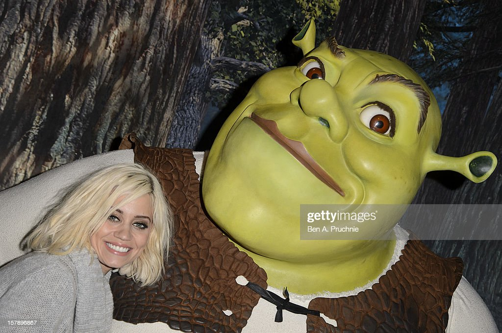 Pussycat Doll Kimberly Wyatt poses next to a wax figure of Shrek at Madame Tussauds on December 7, 2012 in London, England.